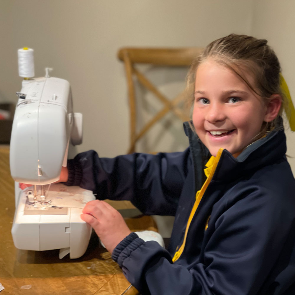 Rosie-learning-to-sew